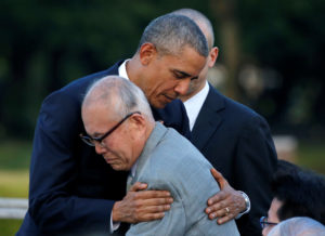 U.S. President Barack Obama (L) hugs with atomic bomb survivor Shigeaki Mori as he visits Hiroshima Peace Memorial Park in Hiroshima, Japan May 27, 2016. REUTERS/Carlos Barria TPX IMAGES OF THE DAY